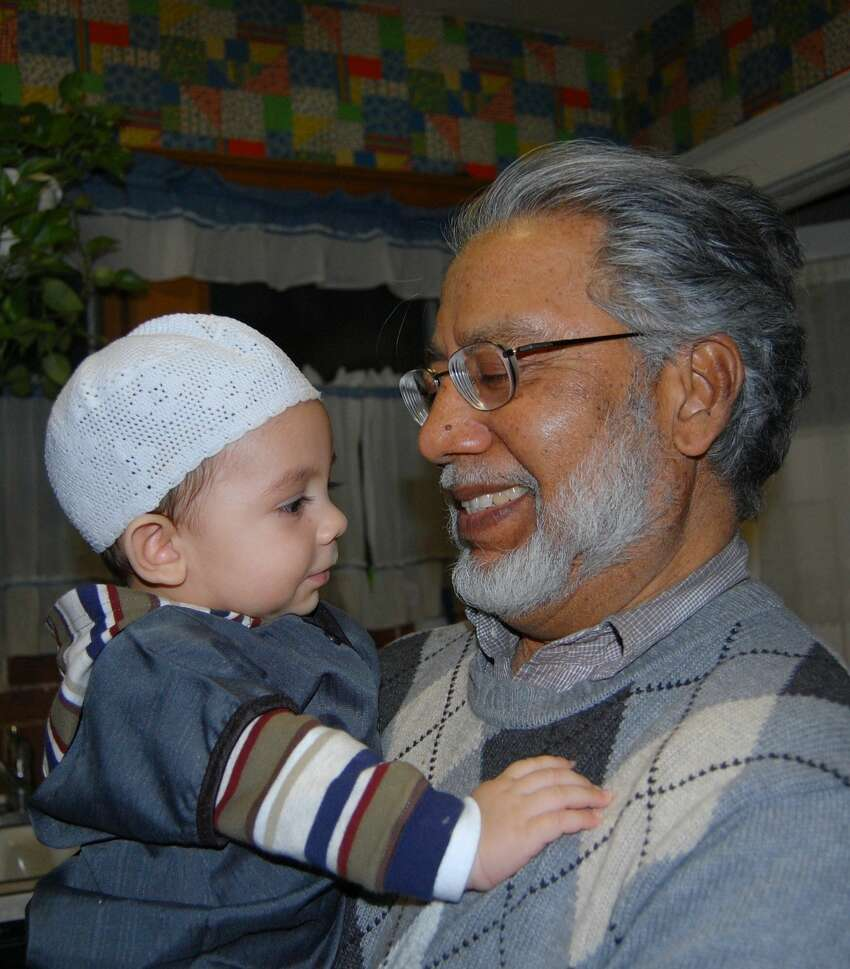 Shamshad Ahmad, president of Masjid As-Salam and UAlbany professor, died Wednesday after a stroke, his family said. Here he is pictured with one of his 11 grandchildren, Nawawi, in an undated photo.