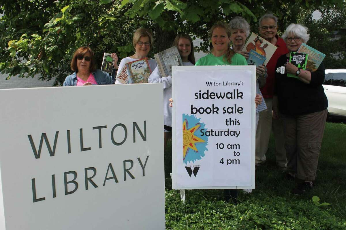 Wilton Library's book sale volunteers will have outdoor shelves stacked with items for sale at the street fair on July 20.
