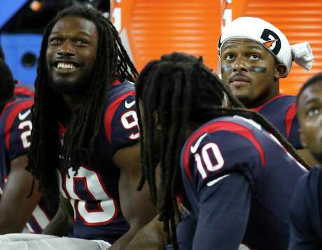 Houston Texans quarterback Deshaun Watson (4) with Jadeveon Clowney (90) and DeAndre Hopkins (10) on the bench during the fourth quarter of an NFL preseason game at NRG Stadium, Saturday, August 18, 2018, in Houston.