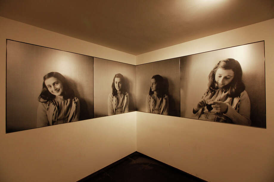 Portraits of Anne Frank in the museum's introduction room. Photo: Cris Toala Olivares, Anne Frank House / Cris Toala Olivares