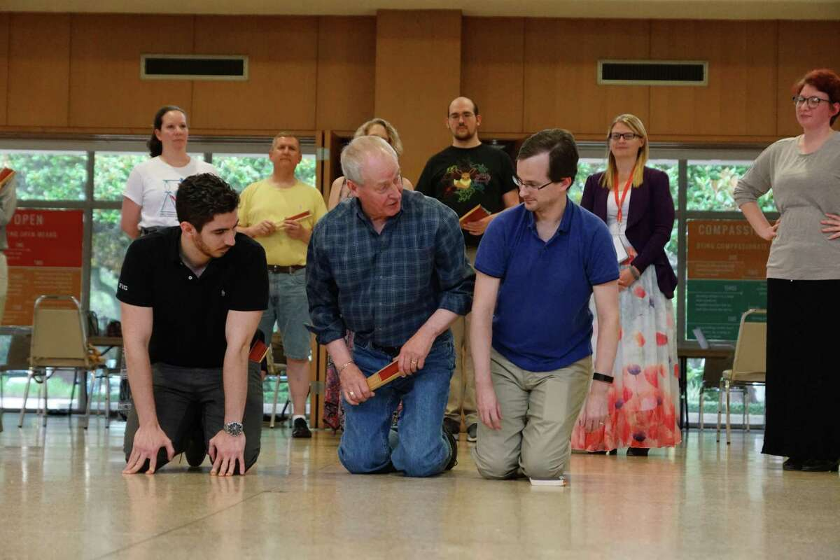 Alistair Donkin, second from left, leads the cast of 'Topsy Turvy Mikado' in a rehearsal.
