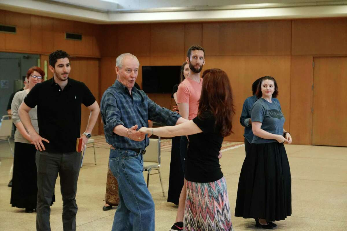 Alistair Donkin (blue shirt) leads the cast in a rehearsal for 'Topsy-Turvy Mikado'