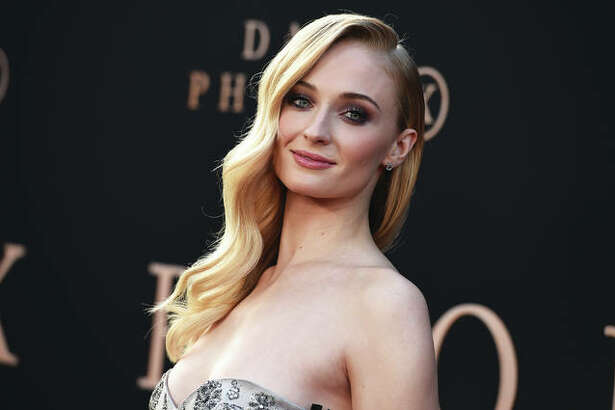 """""""Dark Phoenix"""" cast member Sophie Turner, who plays lead character Jean Grey, who is the Dark Phoenix, arrives at the Los Angeles premiere of the latest X-Men movie at TCL Chinese Theatre."""