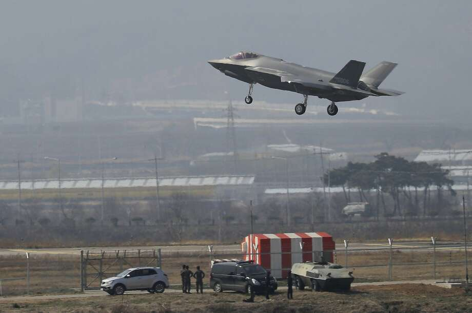 """A U.S. F-35 fighter jet prepares to land in Chungju, South Korea. The North says it will test special weapons to """"destroy"""" the high-tech aircraft. Photo: Kang Jong-min / Associated Press"""