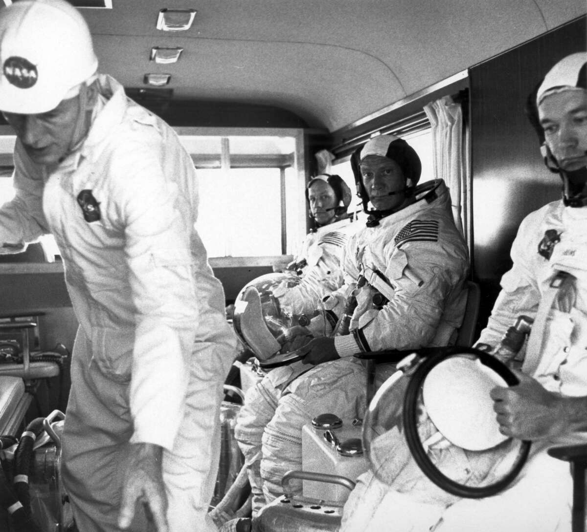 Apollo 11 crew members (rear to front) Neil Armstrong, Edwin Aldrin, and Michael Collins, wearing space suits, ride the van to the launch pad to participate in the countdown demonstration test for the upcoming Apollo 11 mission. The Apollo 11 mission, the first lunar landing mission, launched from the Kennedy Space Center (KSC) in Florida via the Marshall Space Flight Center (MSFC) developed Saturn V launch vehicle on July 16, 1969.