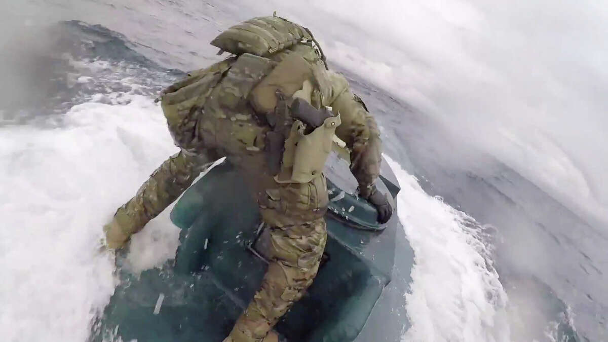 Coastguardsmen from the U.S. Coast Guard Cutter Munro interdict a submersible carrying drugs on June 18, 2019.