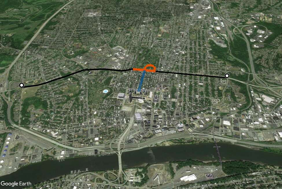In the late 1960s, Albany leaders wanted to build a Mid-Crosstown Arterial in the middle of Albany. The highway would have run from the Thruway and Interstate 90 through the Delaware Avenue neighborhood. The plan called for tunnels under Washington Park (shown in orange), with a connection to the South Mall Arterial (shown in blue) that runs under the Empire State Plaza. The highway would have then continued through Arbor Hill, eventually reconnecting with I-90. (Google Earth illustration by Cathleen F. Crowley / Times Union.)