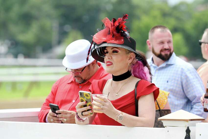 Andrea Virella and her husband Edward Virella wait for the horses to enter the starting gate before the start of the race during opening day at the track on Thursday, July 11, 2019 at Saratoga Race Course in Saratoga Springs, NY. (Phoebe Sheehan/Times Union)