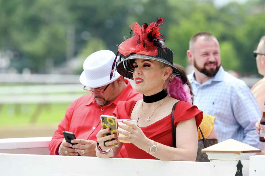 Andrea Virella and her husband Edward Virella wait for the horses to enter the starting gate before the start of the race during opening day at the track on Thursday, July 11, 2019 at Saratoga Race Course in Saratoga Springs, NY. (Phoebe Sheehan/Times Union) Photo: Phoebe Sheehan, Albany Times Union / 40047442A