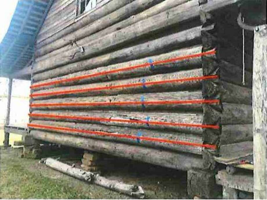The American Log Restoration, Inc. in North Carolina identified six logs that need to be repaired and replaced at Crane Cabin at Fernland Historical Park in Montgomery. Photo: Submitted Photo / Submitted Photo