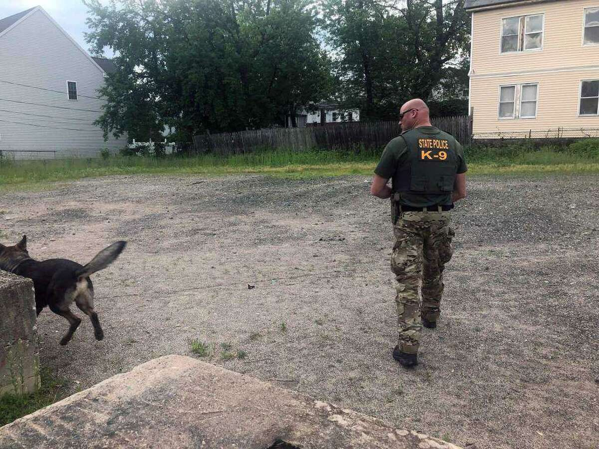 State police search on May 31 an area of Hartford where they say Fotis Dulos was seen on video dumping garbage bags containing Jennifer Dulos' blood.
