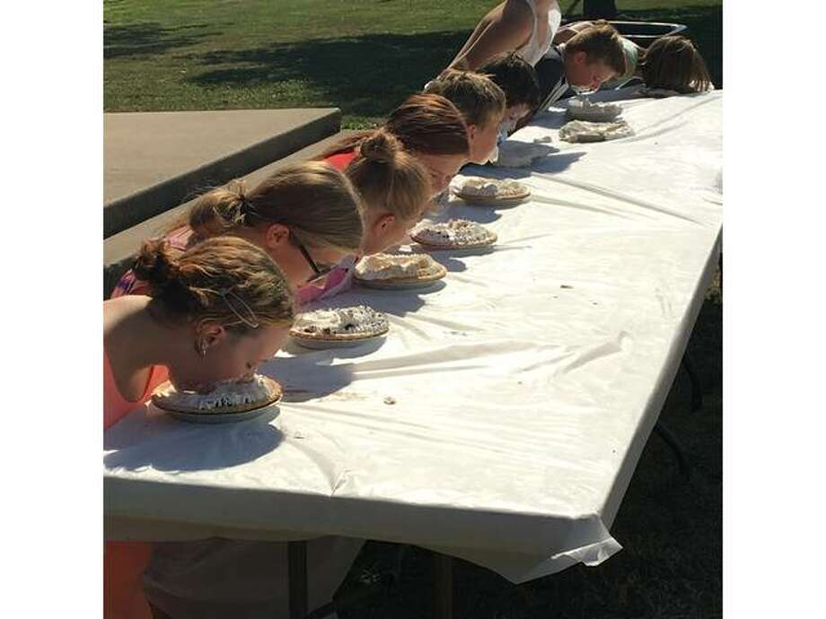 Kids compete in a pie eating contest at the 2018 Wood River Ice Cream Social. This year's event is planned 3-6 p.m. Sunday, July 14 at Central Park in Wood River.