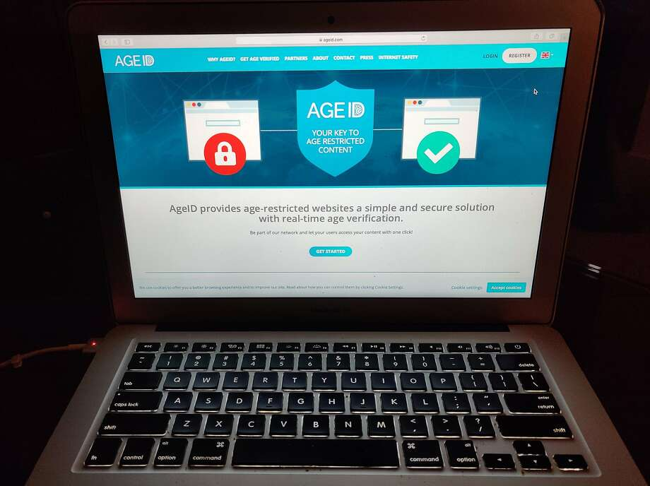 "This photo taken in London on Monday July 8, 2019, shows a laptop screen displaying the website for AgeID, an age verification system for the British government's planned online ""porn block"". The British government wants to require porn websites to verify their users are adults. The effort is being watched by other countries hoping to better regulate pornographic content but has raised concerns about privacy, censorship and competition. It has run into multiple delays that reflect the confusion surrounding it. (AP Photo/Kelvin Chan) Photo: Kelvin Chan / Associated Press"