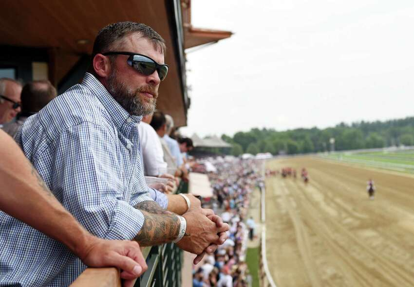 Martin Millington looks out at the race course from the second floor deck of Saratoga Race Course's newest hospitality area during opening day at the track on Thursday, July 11, 2019 at Saratoga Race Course in Saratoga Springs, NY. (Phoebe Sheehan/Times Union)