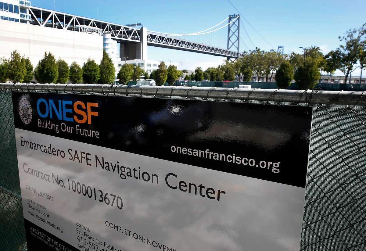 A fence surrounds a parking lot at Beale Street and The Embarcadero where the city intends to construct a homeless navigation center in San Francisco, Calif. on Thursday, July 11, 2019.