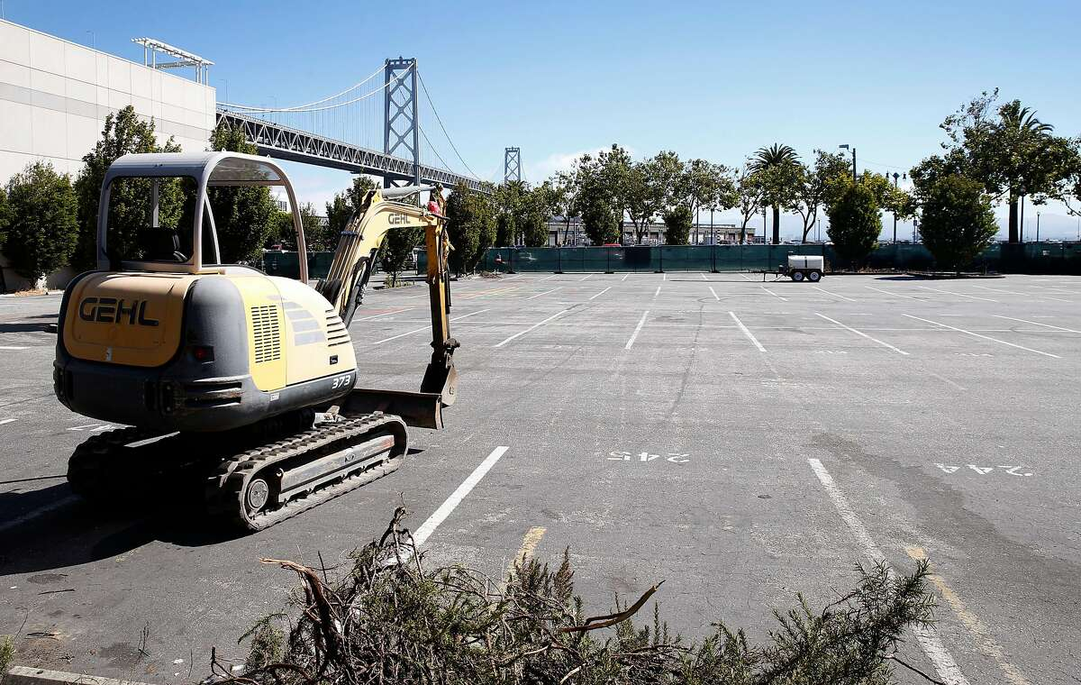 Construction equipment is stored in a parking lot at Beale Street and The Embarcadero where the city intends to build a homeless navigation center in San Francisco, Calif. on Thursday, July 11, 2019.