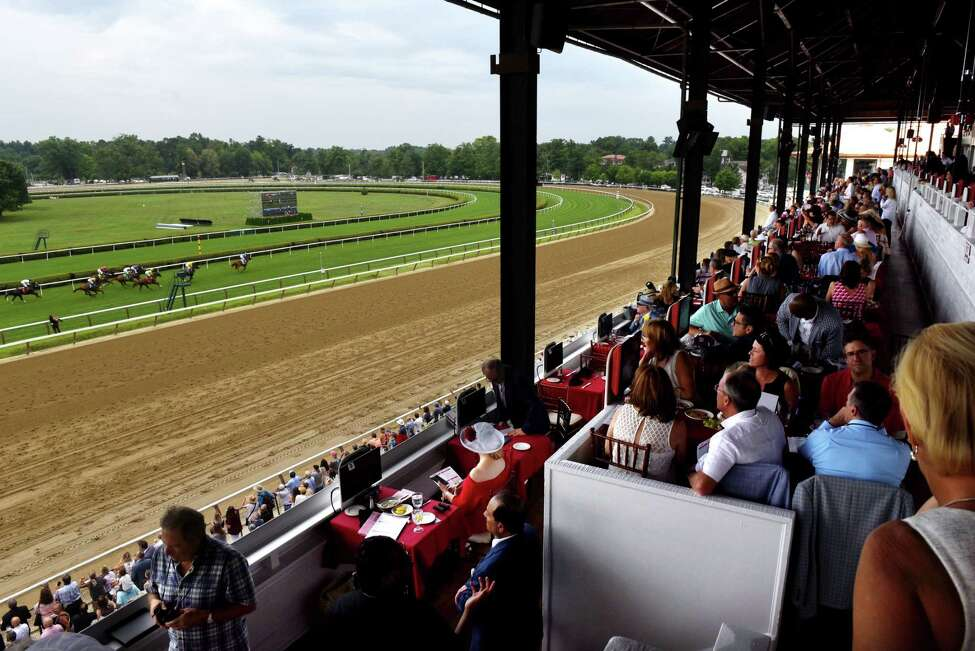 Racing racing fans fill the Turf Terrace for the second race at Saratoga Race Course on Thursday, July 11, 2019, in Saratoga, N.Y. (Will Waldron/Times Union)