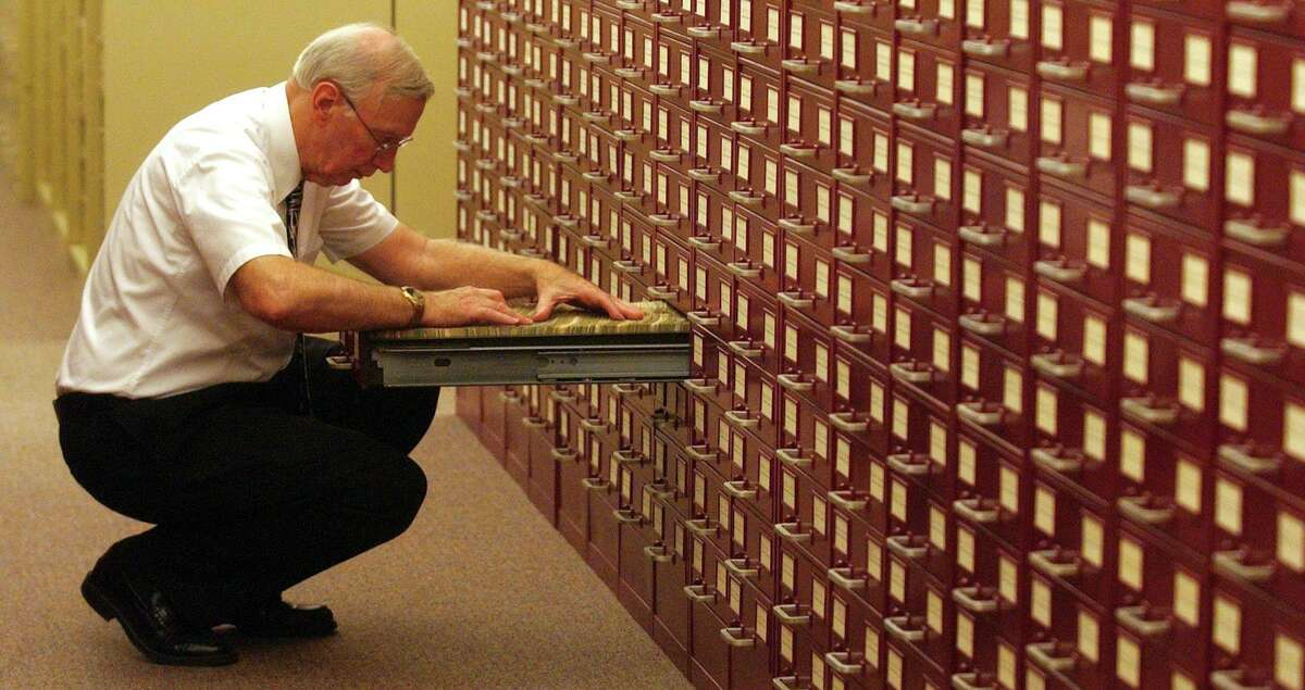 Merriam-Webster senior editor Jim Lowe sifts through a card catalog of entries that track a word's use in the mass media. Aug. 15, 2007, at the dictionary company's headquarters in Springfield, Mass. A newspaper is a playground for a logophile.