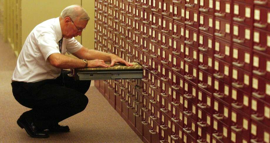 Merriam-Webster senior editor Jim Lowe sifts through a card catalog of entries that track a word's use in the mass media. Aug. 15, 2007, at the dictionary company's headquarters in Springfield, Mass. A newspaper is a playground for a logophile. Photo: Nathan K. Martin /AP / AP