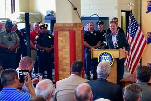 Gov Ned Lamont holds a bill signing ceremony at Engine 10 of the Waterbury Fire Department on June 10 to commemorate the adoption of a state law that will provide workers' compensation benefits to police officers, parole officers, and firefighters who have been diagnosed with post-traumatic stress disorder after witnessing an unnerving event in the line of duty.