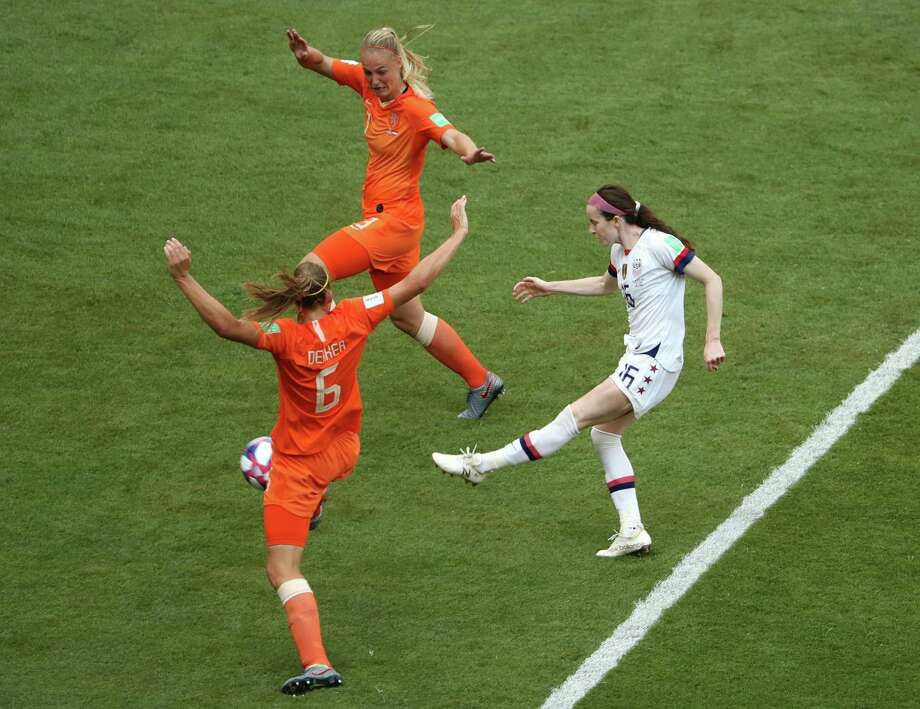 Rose Lavelle of Team USA splits two Dutch defenders and uses a booming left-footed kick to score the final goal Sunday in America's successful defense of its World Cup title. It was an amazing performance for the women's national team, which has been fighting for equal pay with the men's national team. Photo: Robert Cianflone /Getty Images / 2019 Getty Images