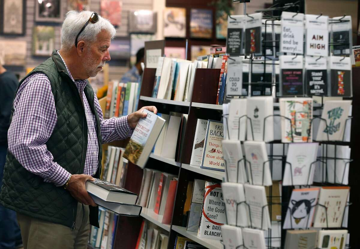 Matt Brooks shops at Books Inc., one of the more popular stores in the Laurel Village shopping district, in San Francisco, Calif. on Thursday, July 11, 2019. Several businesses along the strip on California Street have suddenly shut their doors for good.