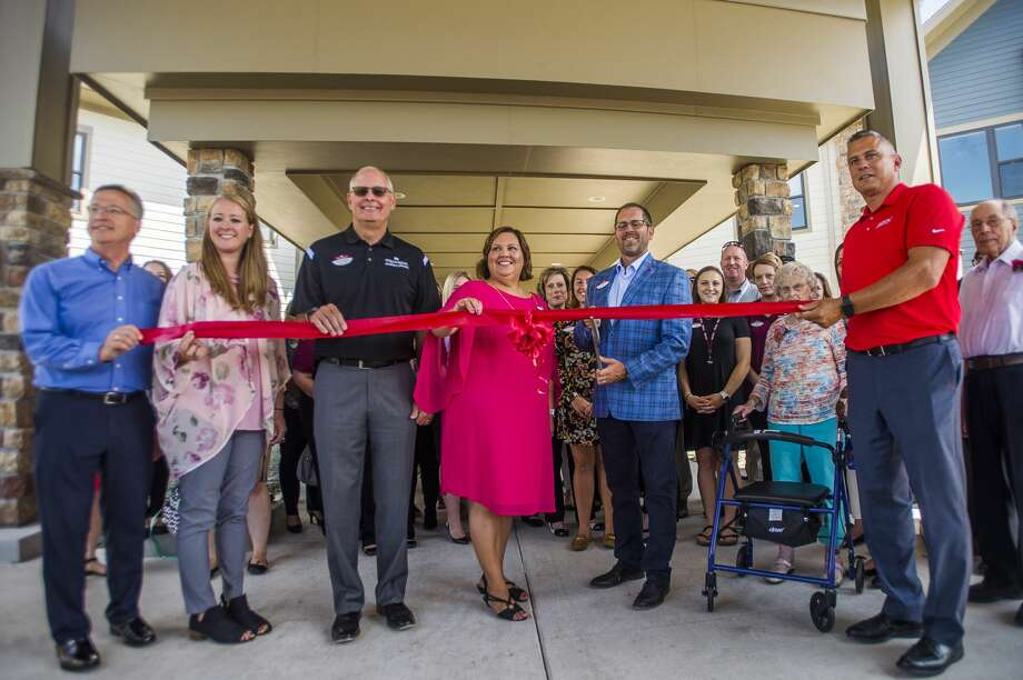 Primrose Retirement Community staff cut a ribbon during an open house for the facility on Thursday, July 11, 2019 at 5600 Waldo Avenue. (Katy Kildee/kkildee@mdn.net) Photo: (Katy Kildee/kkildee@mdn.net)