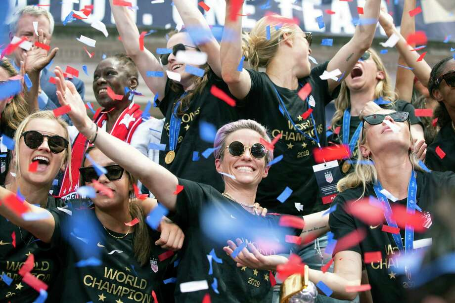 Megan Rapinoe, center, is joined by her teammates on the U.S. women's national soccer team during a celebratory rally at City Hall following a ticker-tape parade in New York on Wednesday, July 10, 2019. The team, which defeated the Netherlands, 2-0, on Sunday in the World Cup final, traversed the Canyon of Heroes, a stretch of Broadway from Battery Park to City Hall. Photo: CALLA KESSLER, STR / NYT / NYTNS