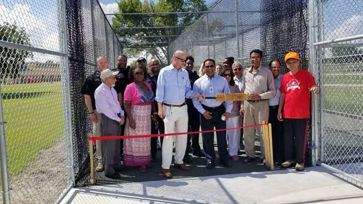 Fort Bend County Judge K.P. George and Precinct 4 Commissioner Ken DeMerchant, with community members, participate in the ribbon cutting ceremony for a new cricket field.