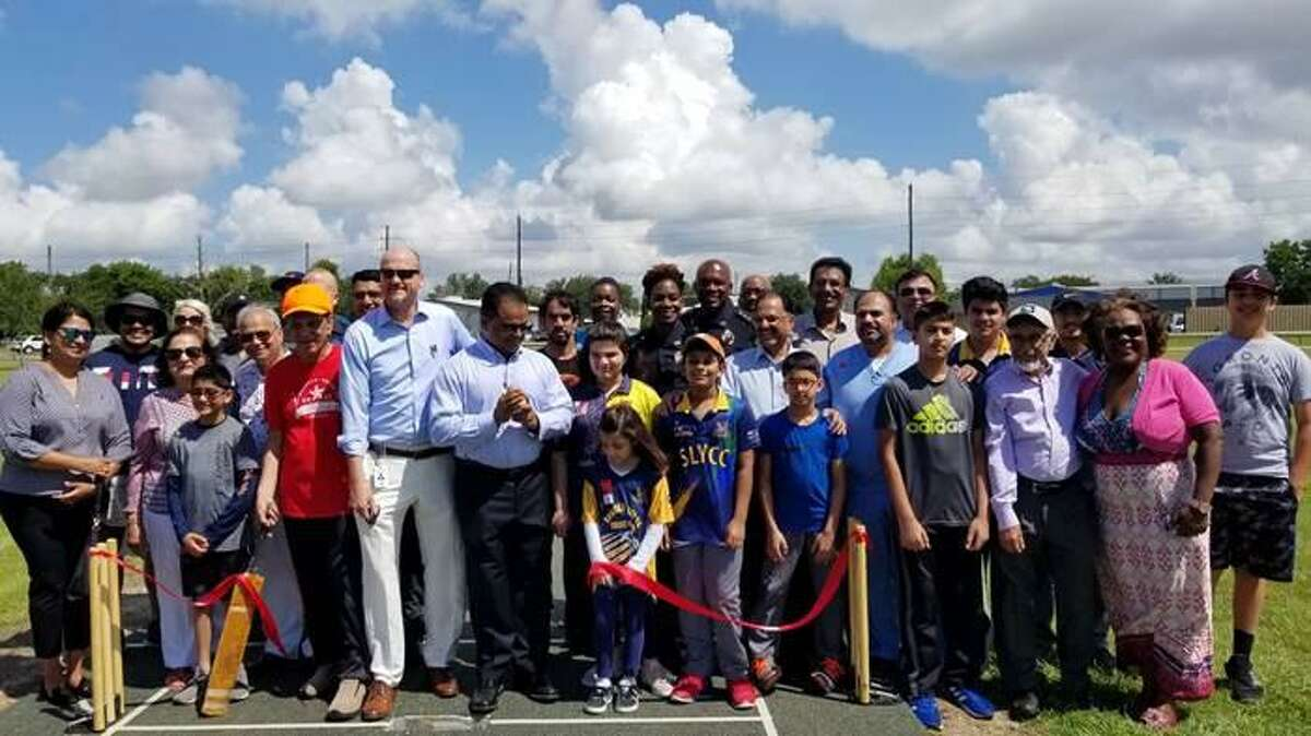 Fort Bend County Judge K.P. George and Precinct 4 Commissioner Ken DeMerchant, with community members, participate in the ribbon cutting ceremony for the county's new cricket fields.