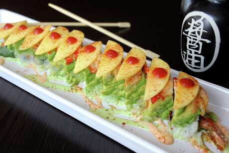 The Sexy Roll is part of the sushi lineup at the newly rebranded Piranha Izakaya.