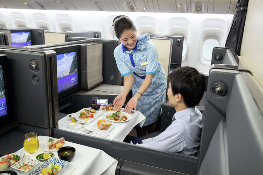 Meal service in business class on ANA's redesigned 777-300ER. Photo: ANA