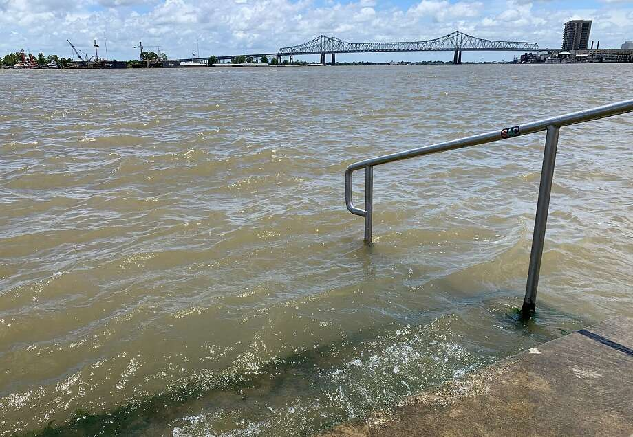 The Mississippi River laps at the stairs on a protective levee in New Orleans as tropical storm Barry approaches on July 11, 2019. - Tropical storm Barry barreled toward rain-soaked New Orleans on July 11 as the city hunkered down for an ordeal that evoked fearful memories of 2005's deadly Hurricane Katrina. (Photo by Michael Mathes / AFP)MICHAEL MATHES/AFP/Getty Images Photo: Michael Mathes, AFP/Getty Images