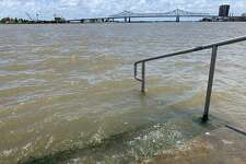 The Mississippi River laps at the stairs on a protective levee in New Orleans as tropical storm Barry approaches on July 11, 2019. - Tropical storm Barry barreled toward rain-soaked New Orleans on July 11 as the city hunkered down for an ordeal that evoked fearful memories of 2005's deadly Hurricane Katrina. (Photo by Michael Mathes / AFP)MICHAEL MATHES/AFP/Getty Images