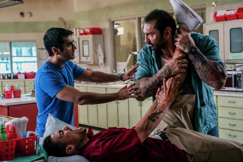 This image released by 20th Century Fox shows Dave Bautista, right, and Kumail Nanjiani, standing left, in a scene from