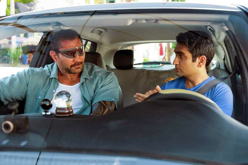 This image released by 20th Century Fox shows Dave Bautista, left, and Kumail Nanjiani in a scene from