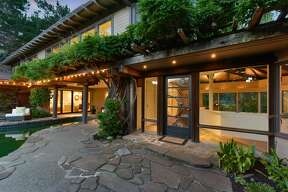 A pool, a view, land, and walkable to hundreds of acres of nature, this Mill Valley mid-century is like a mini-resort.