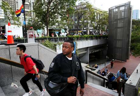 LaRance Braggs heads to BART's Powell Street Station after his shift. Photo: Yalonda M. James / The Chronicle