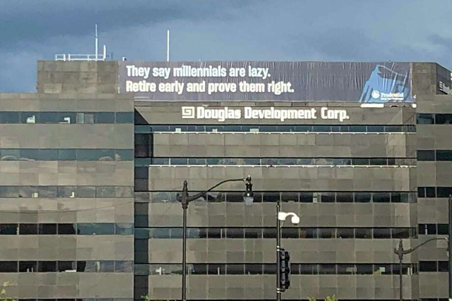 In this June 13, 2019 photo, a retirement advertisement sign is shown on a building in Washington.  Nearly one-quarter of Americans say they never plan to retire, according to a poll that suggests a disconnection between individuals' retirement plans and the realities of aging in the workforce.  (AP Photo/Nancy Benac) Photo: Nancy Benac, STF / Associated Press / AP