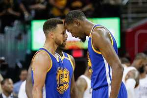 Golden State Warriors' Stephen Curry and Kevin Durant touch heads in the fourth quarter during Game 3 of the 2017 NBA Finals at Quicken Loans Arena on Wednesday, June 7, 2017 in Cleveland, Ohio