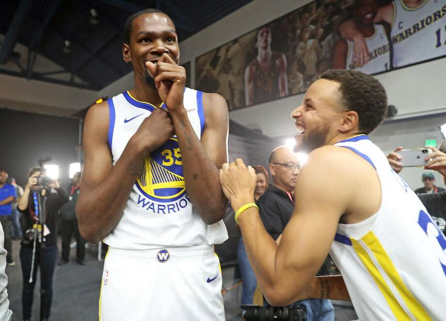 Kevin Durant and Stephen Curry during the 2018 Golden State Warriors' Media Day in Oakland. Photo: Scott Strazzante / The Chronicle 2018