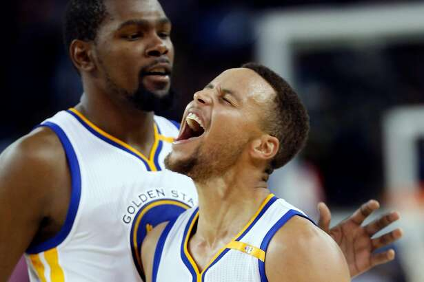 Golden State Warriors' Stephen Curry celebrates his 13th 3-pointer of the game with Kevin Durant during Warriors' 116-106 win over New Orleans Pelicans during NBA game at Oracle Arena in Oakland, Calif., on Monday, November 7, 2016.