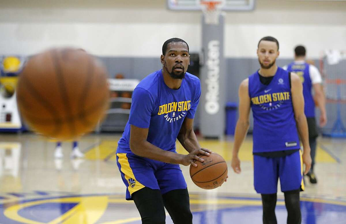 Warriors Kevin Durant, 35 and Warriors Stephen Curry, 30 run drills during a practice session at their facility in downtown in Oakland, Ca. on Fri. May 11, 2018.