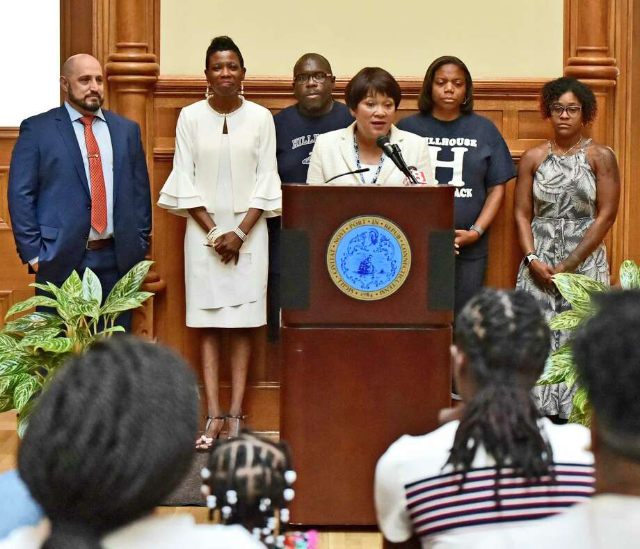 New Haven Mayor Toni Harp, front center, greets the James Hillhouse High School girls basketball — Class L state champions, boys track Class M state champions, and girls track, Class M state champions  during a celebration ceremony Thursday morning at  New Haven City Hall. With Harp are, from left, Athletic Director Erik Patchofsky, Superintendent of Schools Carol Birks, Hillhouse  girls track coach Gary Moore, Hillhouse boys  track coach Michelle Moore and Hillhouse  assistant girls basketball coach Chanel Rice. Photo: Peter Hvizdak / Hearst Connecticut Media / New Haven Register