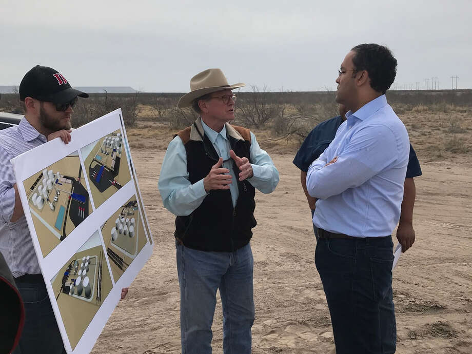 Jack Hanks, president and chief executive officer of MMEX Resources, left, discusses with Congressman Will Hurd renderings of the company's planned crude oil refinery project near Fort Stockton. Hurd sees his time serving in the House of Representatives as a learning experience, especially about the region's oil and gas industry. Photo: Courtesy MMEX Resources