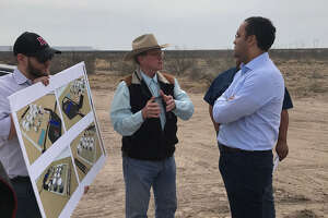 Jack Hanks, president and chief executive officer of MMEX Resources, left, discusses with U.S. Will Hurd renderings of the company's planned crude oil refinery project near Fort Stockton.