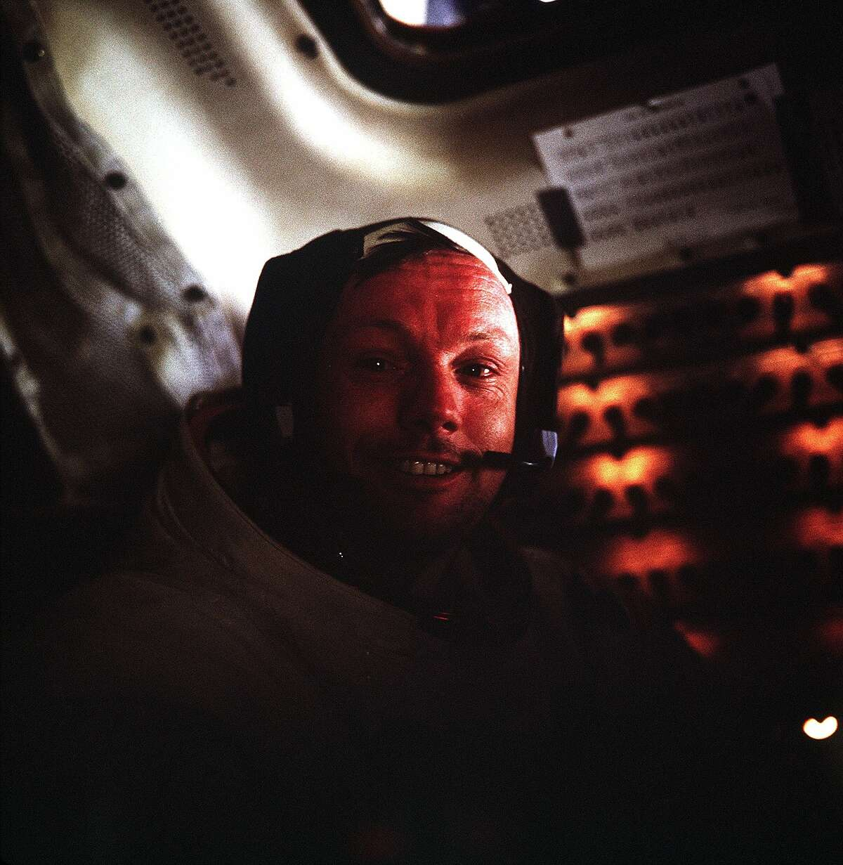 (20 July 1969) --- This photograph of astronaut Neil A. Armstrong, Apollo 11 commander, was taken inside the Lunar Module (LM) while the LM rested on the lunar surface. Astronauts Armstrong and Edwin E. Aldrin Jr., lunar module pilot, had already completed their historic extravehicular activity (EVA) when this picture was made. Astronaut Michael Collins, command module pilot, remained with the Command and Service Modules (CSM) in lunar orbit while Armstrong and Aldrin explored the moon's surface.