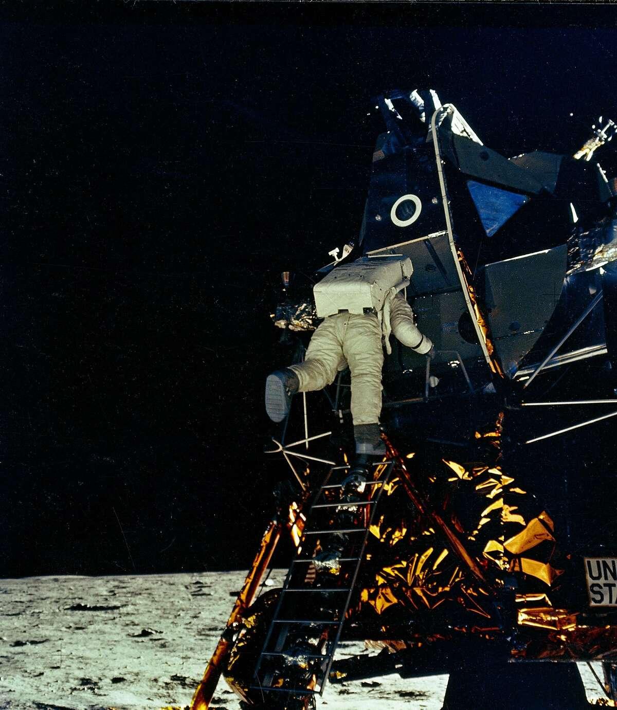 Apollo 11 astronaut Edwin Aldrin, Jr. egresses the luna module on the moon.