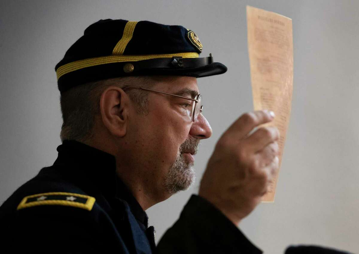 Stephen Duncan, portraying Union Army General Gordon Granger, holds up a copy of General Order No. 3 at the 40th Annual Al Edwards' Juneteenth Prayer Breakfast at Ashton Villa in Galveston, Texas on Wednesday, June 19, 2019. Juneteenth commemorates the June 19, 1865 announcement of the abolition of slavery in Texas.