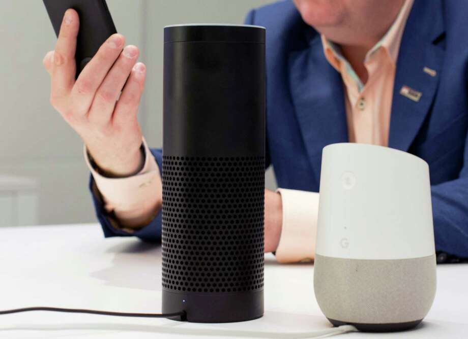 FILE - In this June 14, 2018, photo, an Amazon Echo, center, and a Google Home, right, are displayed in New York. Google contractors are listening to some recordings of people talking to Assistant, either on their phone or through smart speakers such as the Google Home. The company says some of its Dutch language recordings were leaked and that it is investigating. (AP Photo/Mark Lennihan, File) Photo: Mark Lennihan / Copyright 2018 The Associated Press. All rights reserved.